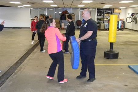 Woman Practicing Self-Defence on Man Holding Padded Square